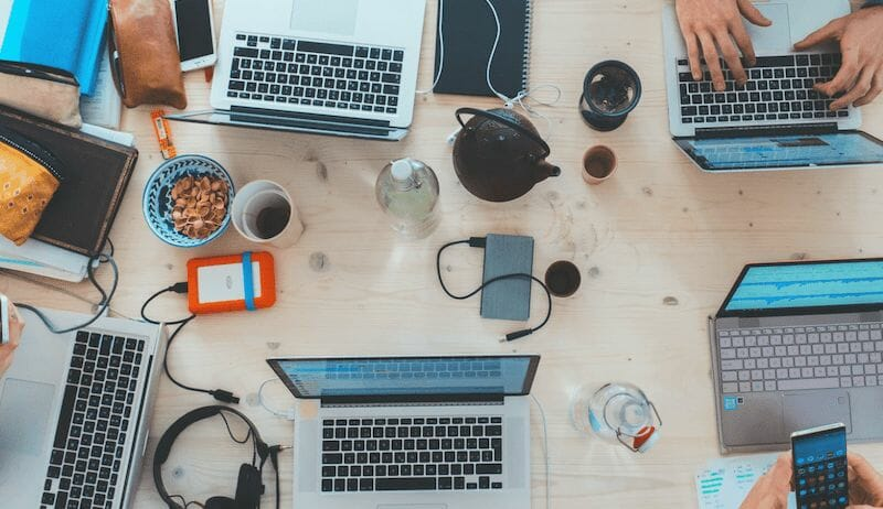 people_sitting_down_near_table_with_assorted_laptop_computers_photo_-_free_business_image_on_unsplash